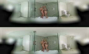 Lesbians having fun under the shower
