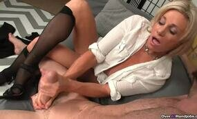 Mature blonde giving good handjob
