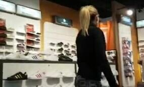 Girl in leggings at the shoe shop