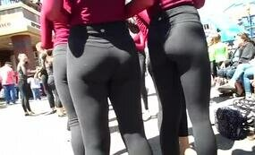 Group of asses in black leggings