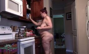 Chubby naked cooking